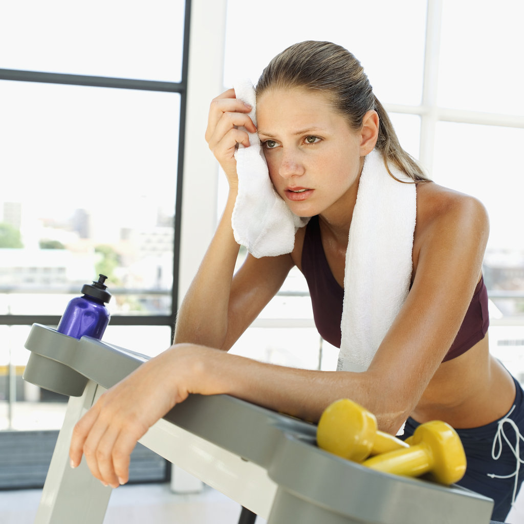 Wiping-Down-Gym-Equipment